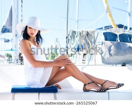 Beautiful woman relaxing on a yacht - stock photo