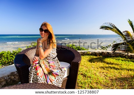 beautiful woman relaxing on the shore of the ocean - stock photo