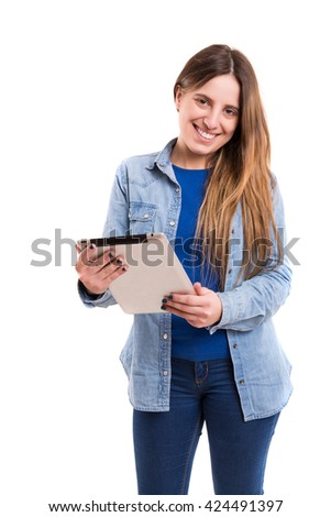 Beautiful woman relaxing with a tablet computer - stock photo