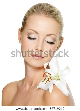 Beautiful  woman relaxing  with white lily on her body, isolated on white - stock photo