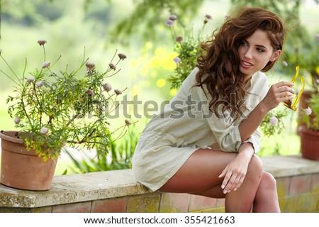 Beautiful woman resting in the summer the Italian garden - stock photo