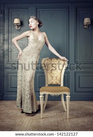 Beautiful woman retro portrait in vintage interior - stock photo