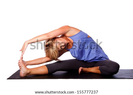 Beautiful woman Revolved Head to Knee Forward Bend Parivrtta Janu Sirsasana in yoga stretching, on white. - stock photo