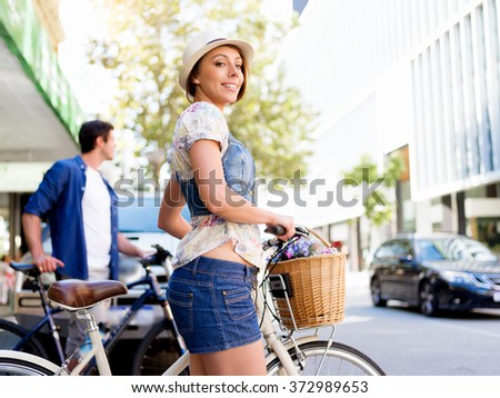 Beautiful woman riding on bike - stock photo
