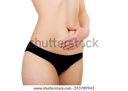 Beautiful woman's belly. - stock photo