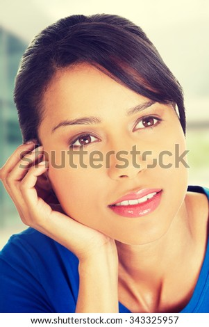 Beautiful woman's face in a closeup while thinking - stock photo