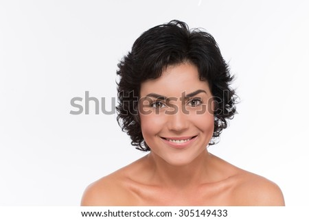 Beautiful woman's face with clean skin isolated on white background. Middle-aged smiling lady having perfect face and neck skin. - stock photo
