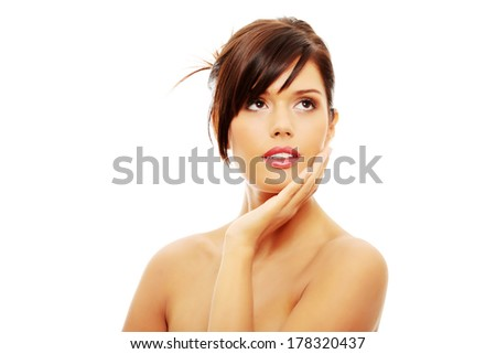 Beautiful woman's face with fresh clean skin isolated on white - stock photo