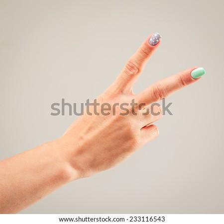 beautiful woman's hand, palm up. gray background - stock photo