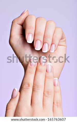 Beautiful woman's hands with beautiful  nails after manicure salon with french manicure - stock photo