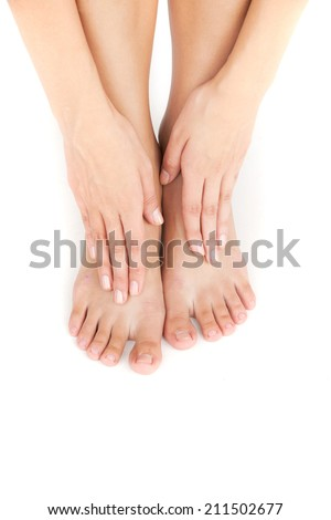 Beautiful woman's legs and hands on feet. Beautiful girl legs and hands isolated on white background - stock photo