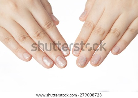 Beautiful woman's nails with manicure on white background - stock photo