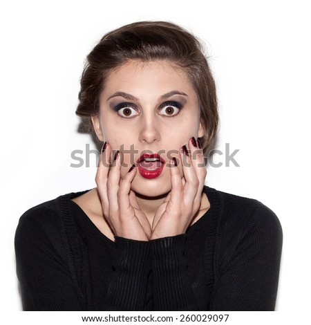 Beautiful woman scared. Surprised girl on a white background - stock photo