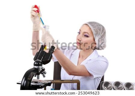beautiful woman scientist in the lab perform various operations - stock photo