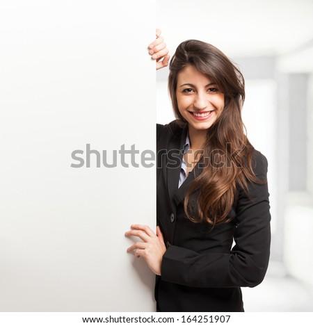 Beautiful woman showing a white board - stock photo