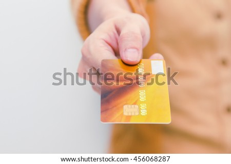 Beautiful woman showing credit card for online payment, hands holding a credit card and using for online shopping,shopping card,shopping content. - stock photo