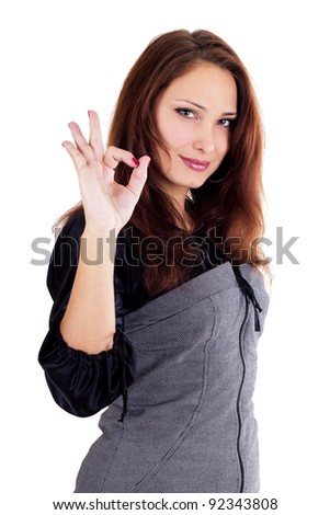 Beautiful woman showing okay isolated on white - stock photo