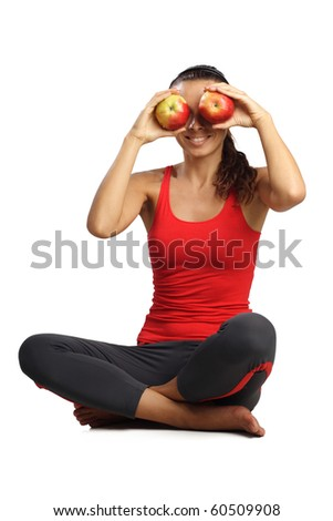 beautiful woman sitting and hold apples near eyes isolated in white - stock photo
