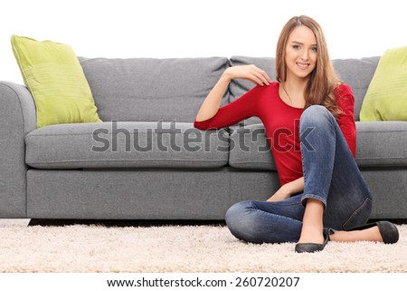 Beautiful woman sitting on a floor isolated on white background - stock photo