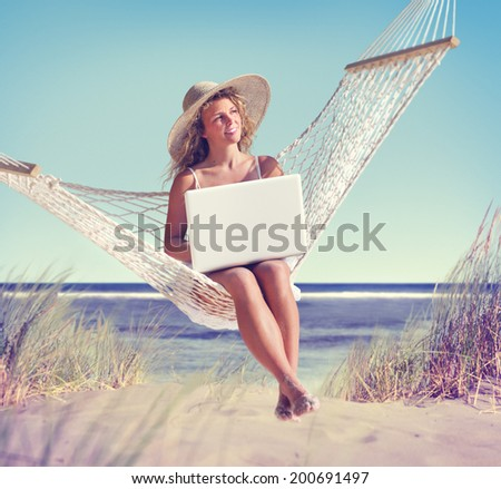 Beautiful Woman Sitting on a Hammock by the Beach - stock photo