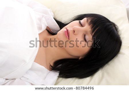 Beautiful woman sleeping in the bed at home - stock photo