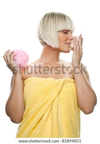 beautiful woman smelling organic soap - stock photo