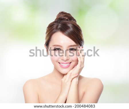 Beautiful woman smile face with clean face skin and health teeth, concept for skin care, over nature green background, asian - stock photo
