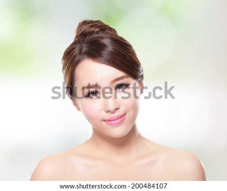 Beautiful woman smile face with clean face skin, concept for skin care, over nature green background, asian - stock photo