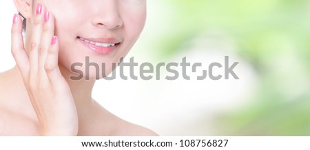 Beautiful woman smile mouth and lips with health teeth close up on nature green background, concept for skincare and dental health care , model is a asian girl - stock photo