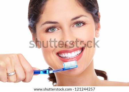 Beautiful woman smile with a toothbrush isolated on white background. - stock photo