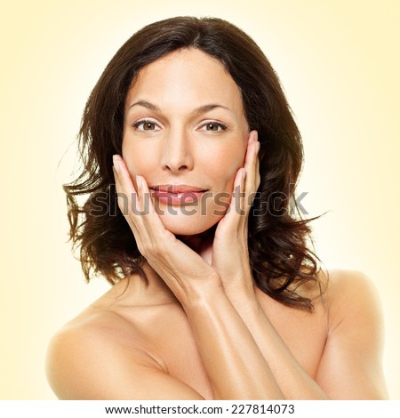 Beautiful woman smiling - close up. White background. - stock photo