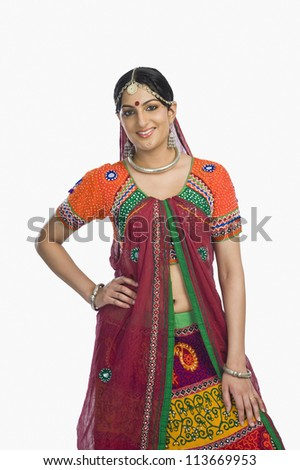 Beautiful woman smiling in lehenga choli - stock photo