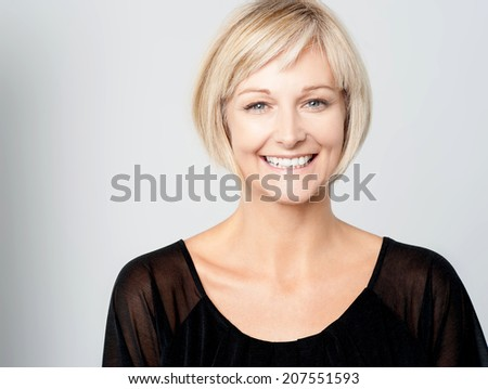 Beautiful woman smiling isolated over a grey - stock photo