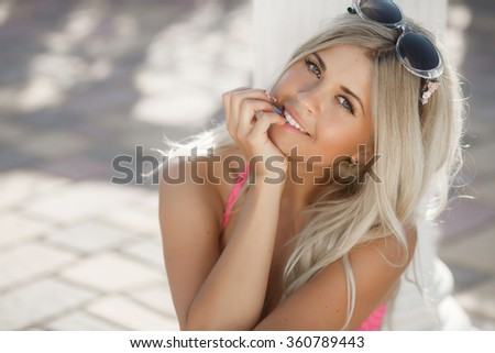 Beautiful woman smiling Outdoors portrait, happy girl at summer beach, Carefree and free cheering woman at vacation,sexy blonde woman summer portrait,  series - stock photo