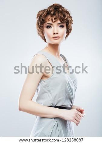 Beautiful woman standing against studio background. Fashion style portrait redhead model. - stock photo