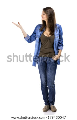 Beautiful woman standing over a white background and talking with someone - stock photo