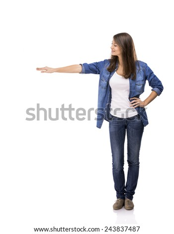 Beautiful woman standing over a white background with copyspace for the designer - stock photo