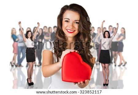 Beautiful woman stands foreground on the blurred people and white background - stock photo
