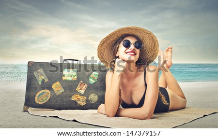 beautiful woman sunbathing at the beach - stock photo
