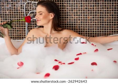 Beautiful Woman Takes Bubble Bath. - stock photo