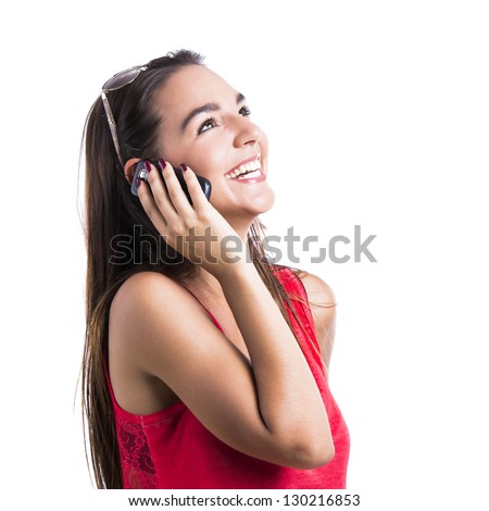 Beautiful woman talking at cell phone, isolated over white background - stock photo