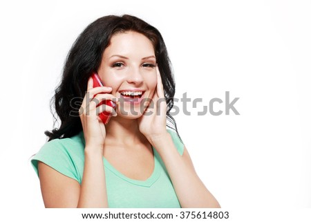 beautiful woman talking on mobile with happy smile hearing good news - stock photo