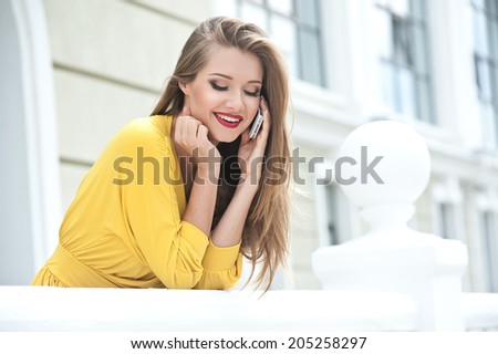 Beautiful woman talking on the phone  - stock photo
