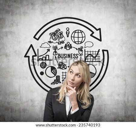 beautiful woman thinking about business structure - stock photo