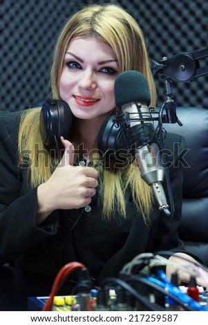 Beautiful Woman Thumbs Up While Recording Sound In Media Studio - stock photo
