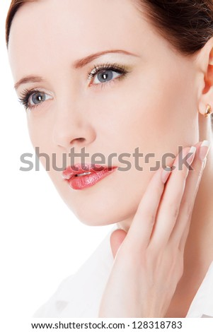 Beautiful woman touches her face - stock photo