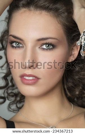 Beautiful woman touching hair with her hands. Seduction concept. - stock photo