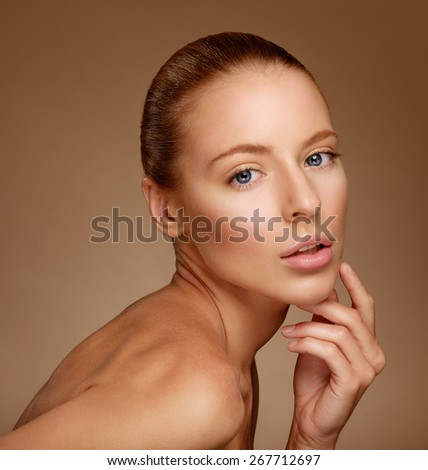 Beautiful Woman Touching her Face. Perfect Fresh Skin. Pure Beauty Model. Youth and Skin Care Concept - stock photo