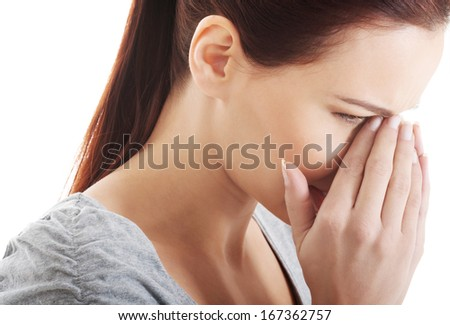 Beautiful woman touching her nose, feeling pain. Isolated on white. - stock photo
