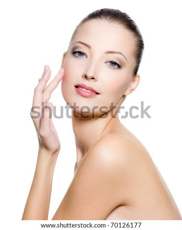 Beautiful woman touching the cheek on face - on white background. - stock photo